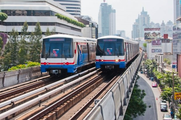 Two BTS SkyTrains pass each other at the Nana station on the Sukhumvit Line.